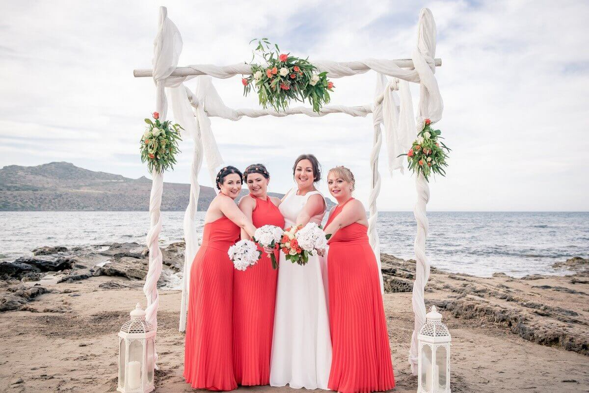 Bride with bridesmaids at Crete beach wedding