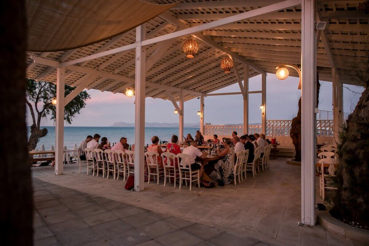Crete beach wedding breakfast at a taverna with fairy lights