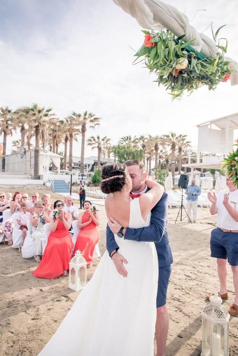 Kiss at Crete beach wedding