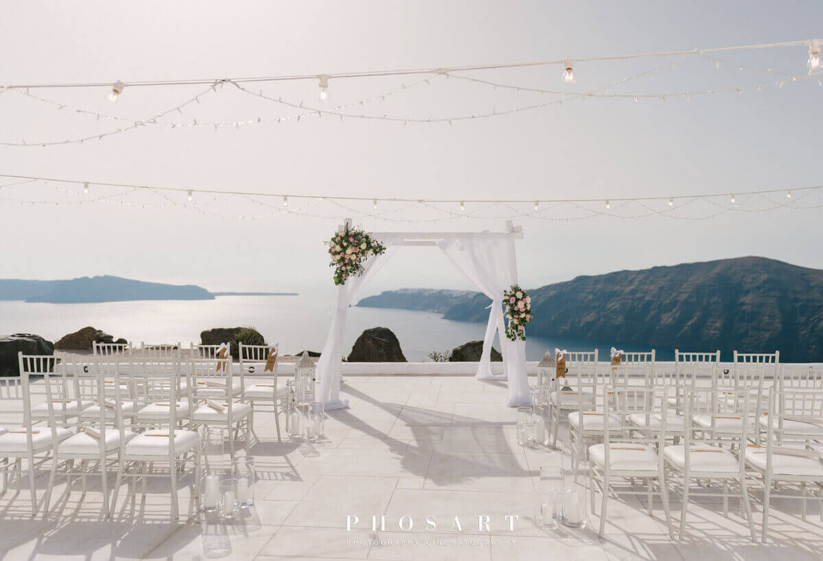 Gazebo arch with flowers at luxury boutique spa hotel wedding venue santorini