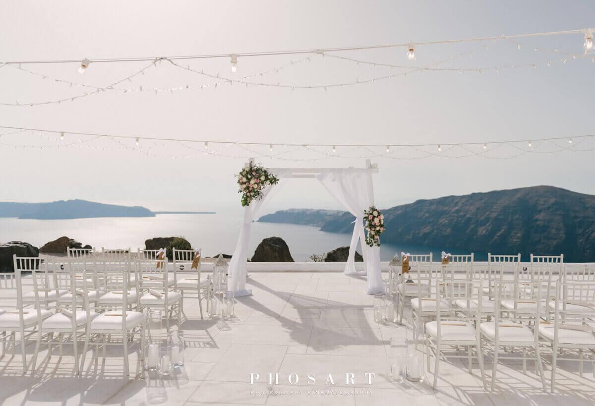 Gazebo arch with flowers at luxury boutique spa hotel wedding venue santorini