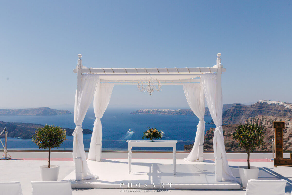Gazebo draped in white fabric at luxury private estate wedding venue in santorini