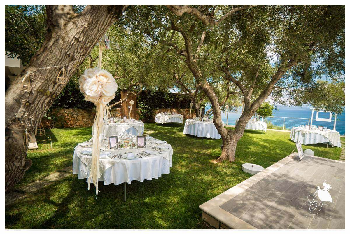Dinner set up under the olive trees at our private villa wedding zaknthos